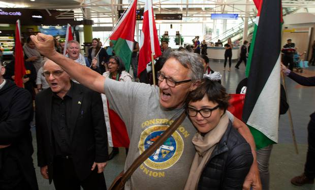 Activist Mike Treen and supporters chant support for Gaza at Auckland Airport. Photo / Brett Phibbs