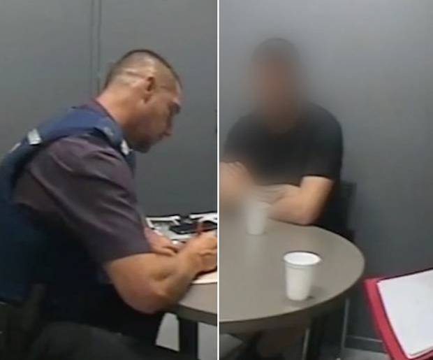 The accused during his second interview with police and Detective Ewen Settle, left.