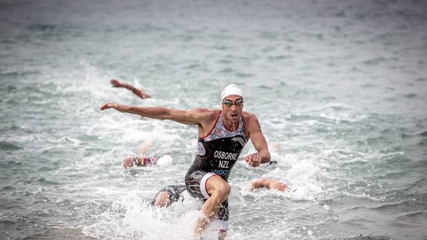 Rotorua athlete Sam Osborne sprints out of the water at Xterra Taiwan. Photo / Supplied