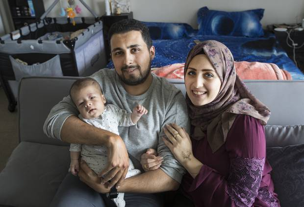 Ahmed Alkazaz, his wife Nagham Eldemiri and their 2-month-old baby Adam. Alkazaz was found to have been unjustifiably dismissed from his IT job. Photo / Brett Phibbs