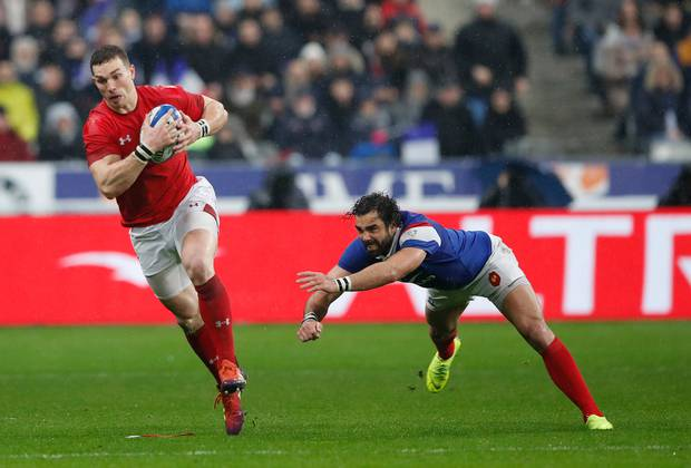 Wales' George North makes an interception and gets away from France's Yoann Huget before scoring his side's third try. Photo / AP.