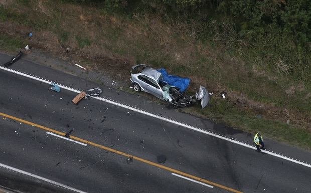 The driver of this car died after colliding with a logging truck on notoriously dangerous State Highway 2 near Omokoroa. Photo / File