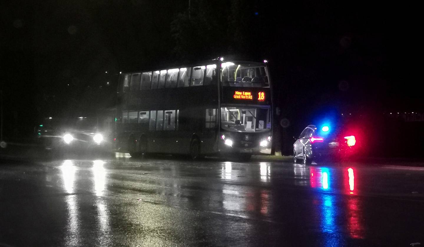 Police at the scene of a serious assault on a bus driver on board his bus on Wednesday night. Photo / Hayden Woodward