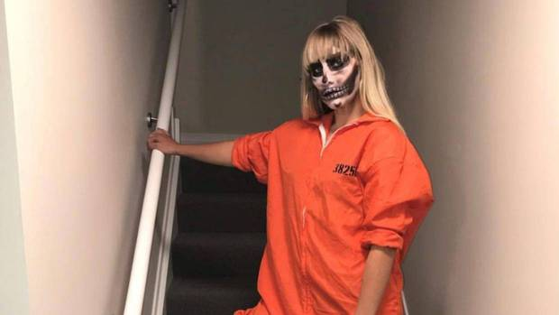 Rouxle Le Roux posted a picture of herself wearing an orange prison jumpsuit on Instagram. Photo / Instagram