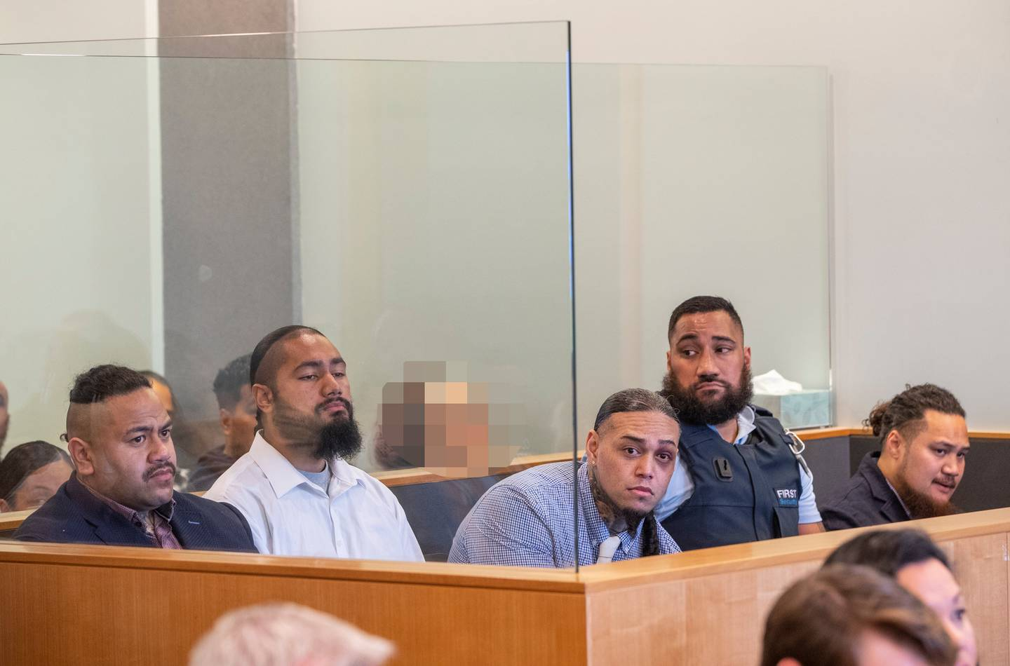 Tevita Fangupo (left), Toni Finau and Tevita Kulu, with Halane Ikiua at the far right, during their sentencing at the Auckland High Court. Photo / Peter Meecham