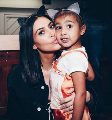 f4b5e97e825ae Kim Kardashian has revealed she had to bribe daughter North to wear Kanye s  Yeezy shoes.