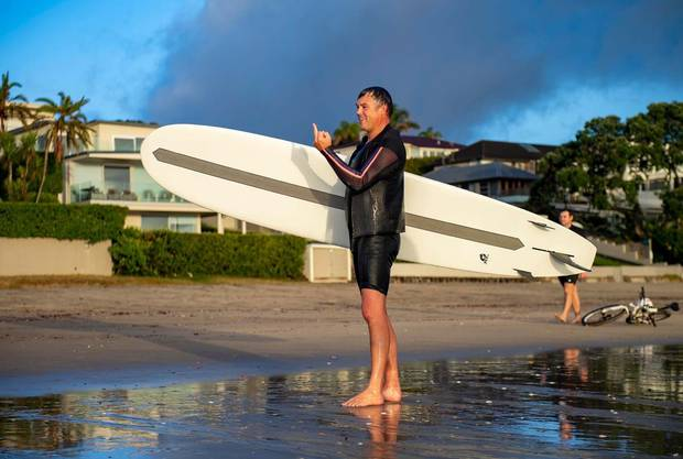 A man reacts after a heated conversation about him breaching the Covid-19 lockdown rules by surfing this morning. Photo / Supplied
