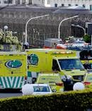 Emergency services outside Parliament after a man set himself on fire. Photo / Marty Melville