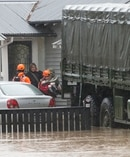 Residents were rescued from their flooded homes in Christchurch yesterday as a state of emergency was called in the city and the Heathcote River rose. Photo/AP/Mark Baker