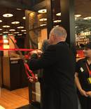 Restaurant Brands chief executive Russel Creedy and chairman Ted van Arkel opening KFC's new Fort Street store.