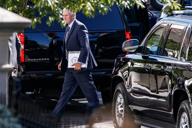 Vice President Mike Pence arrives to the West Wing of the White House, Sunday. Photo / AP