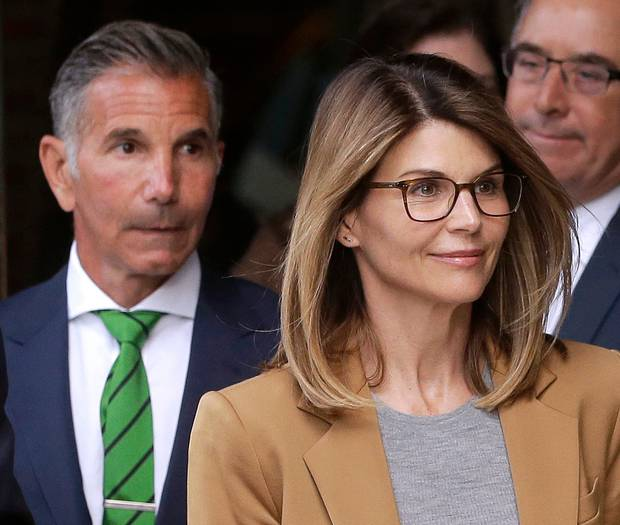 Lori Loughlin plead not guilty to paying $500,000 in bribes to get her daughters into the University of Southern California. Photo / AP