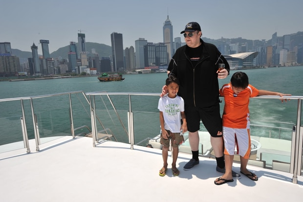 Kim Dotcom with former wife Mona's brothers, Auji and Nelvien, about 10 years ago. Photo / Supplied