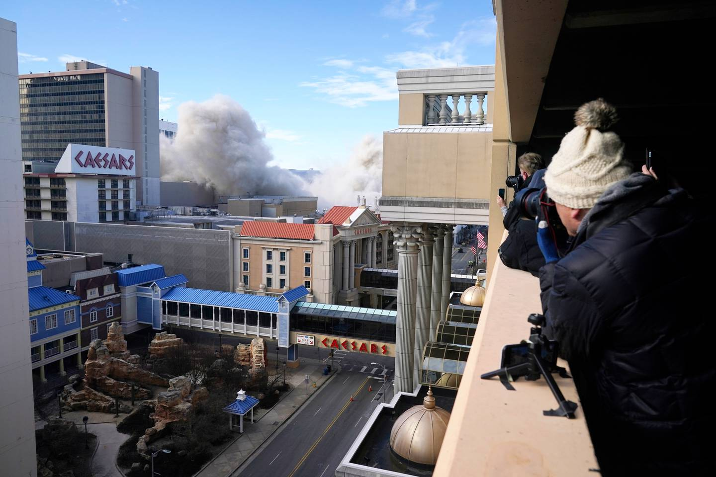 Trump Plaza collapsed in a wave from back to front until it plunged straight down in a giant cloud of dust. Photo / AP