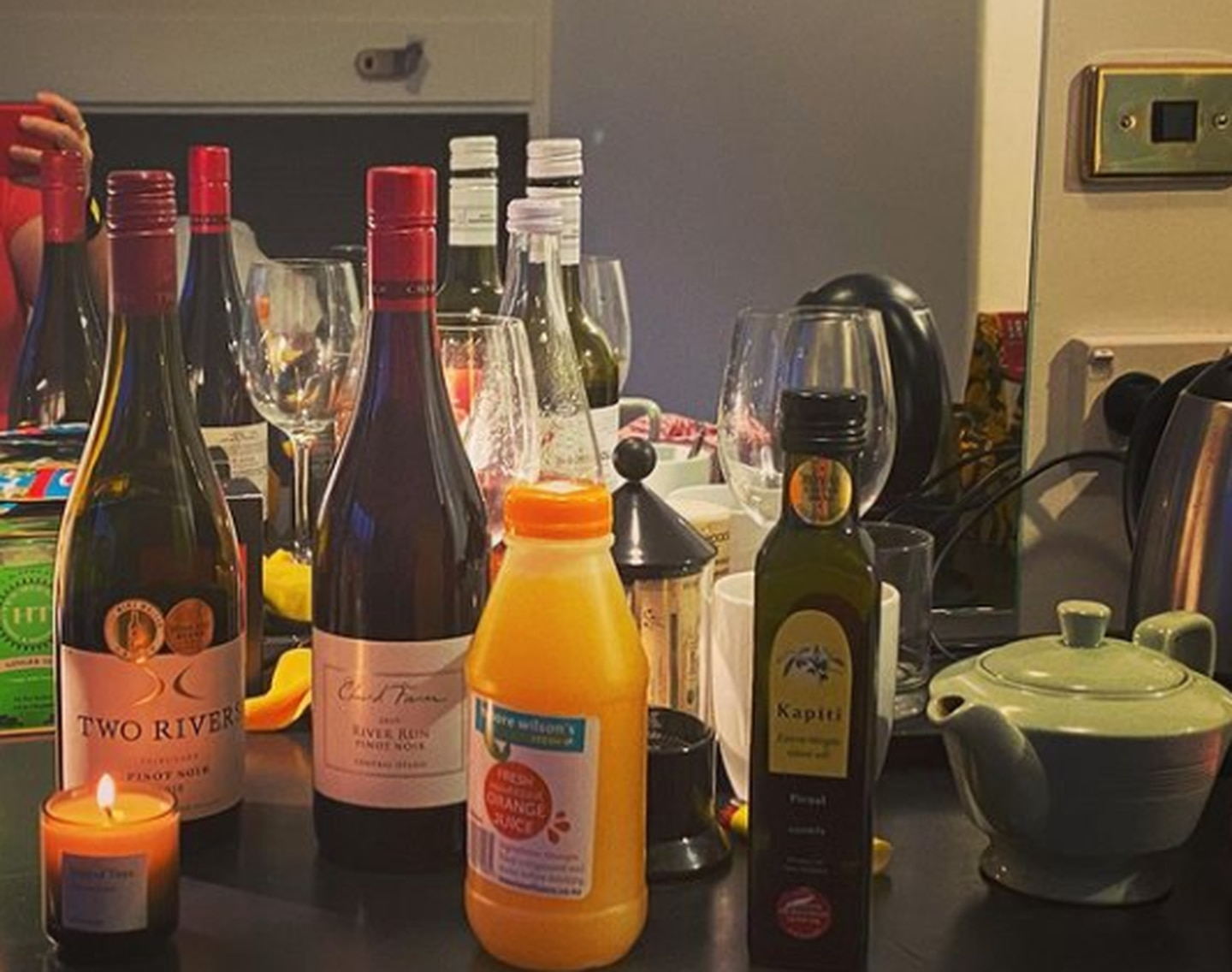 The offending items that appear to have alerted authorities include a lit candle, and more than one bottle of wine. Photo / @robynjmalcolm