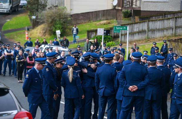 Hundreds of police officers, well-wishers and family gathered yesterday to perform a karakia at Reynella Drive in Massey, West Auckland where Constable Matthew Hunt was slain on Friday. Photo / Alex Burton