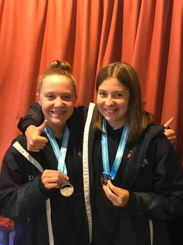 Nikita Pola (left), 14, and Lina Stahlhut, 14, won medals at the New Zealand Age Group Swimming Championships in May. Photo / Supplied