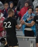 New Zealand All Black Wing Rieko Ioane celebrates after scoring against the Lions. Photo / Greg Bowker