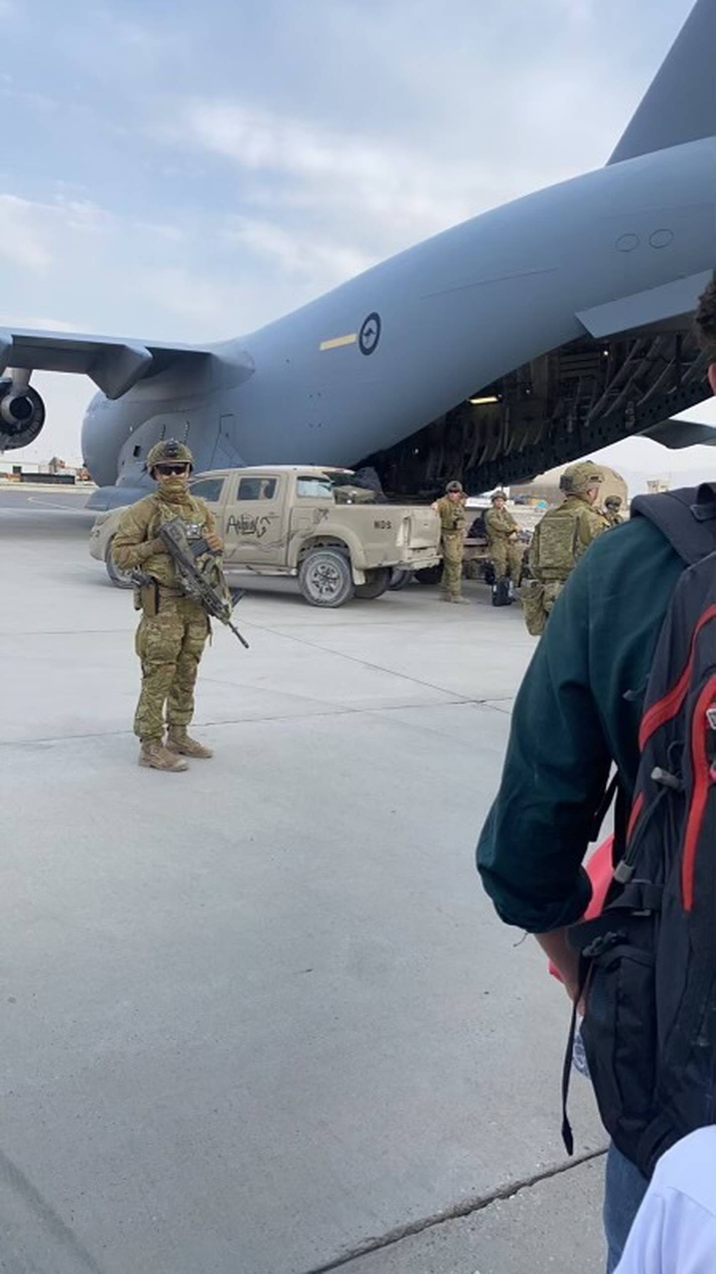 Abdul's family took this photograph as they were led onto the waiting evacuation plane at Kabul airport on Sunday. Photo / Supplied