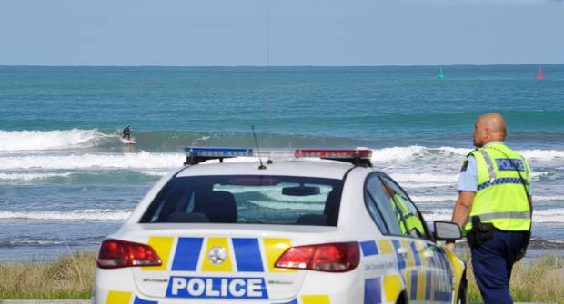 Police keeping tabs on surfers at a popular beach in Gisborne. Photo / Gisborne Herald