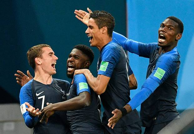France's Samuel Umtiti, second from left, is congratulated by his teammates after scoring. Photo / AP