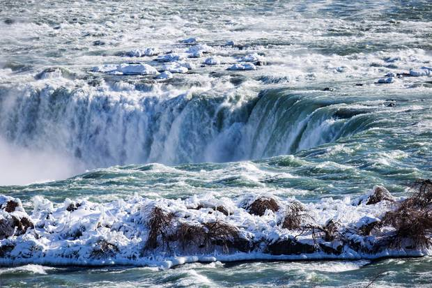 Ice and water flows over the brink of the Horseshoe Falls in Niagara Falls. Photo / AP