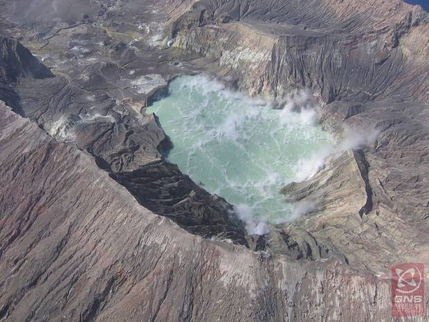 White Island's crater lake, which comes and goes, is coloured by the hardy extremophile bacteria that live within it. Photo / GNS Science