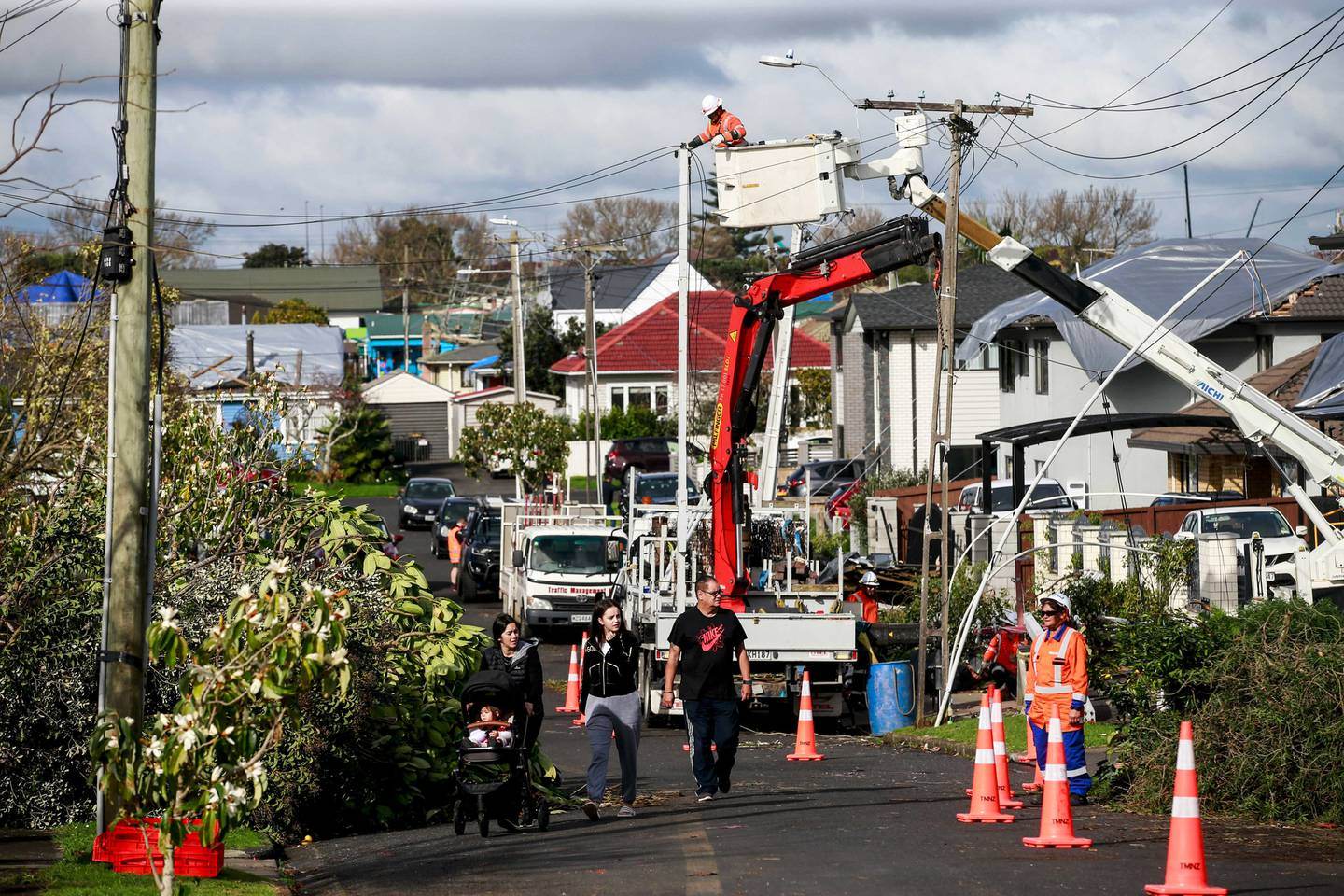 Vector personnel repair damage to powerlines on Hayward Rd sustained in the tornado that ripped through Papatoetoe. Photo / Alex Burton