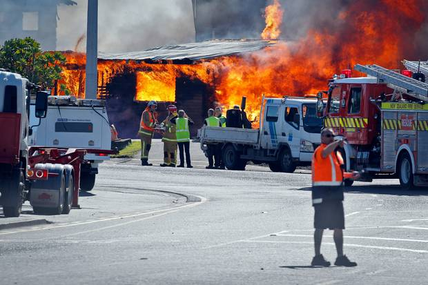 A building burns at the Port of Tauranga as emergency services work out how to tackle the blaze. Photo/Andrew Warner