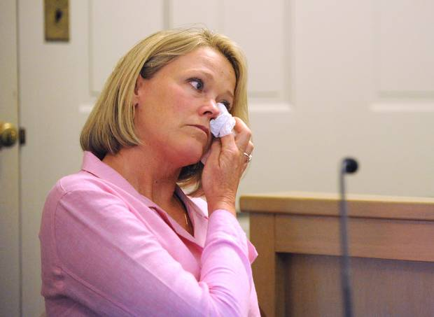 Heather Unruh, former Boston TV news anchor and the accuser's mother, wipes away tears at the start of her testimony in Nantucket District Court. Photo / AP