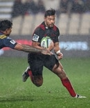 Richie Mo'unga attempts to make a break past Malakai Fekitoa. Photo / photosport.nz