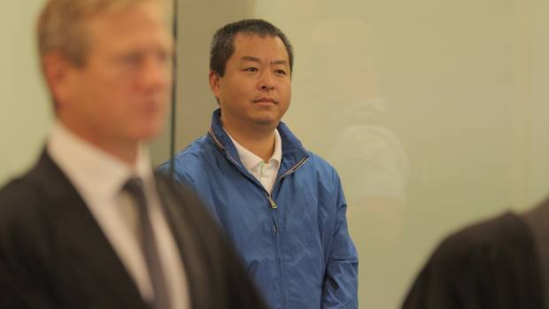 Kang Huang appears at Auckland High Court for sentencing. Photo / Michael Craig