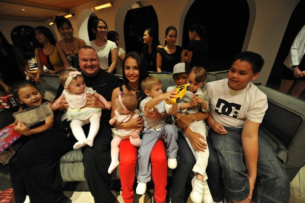The Dotcom family Christmas in 2012. Auji Dotcom is on the sofa, third from the right in a cap. Photo / Supplied