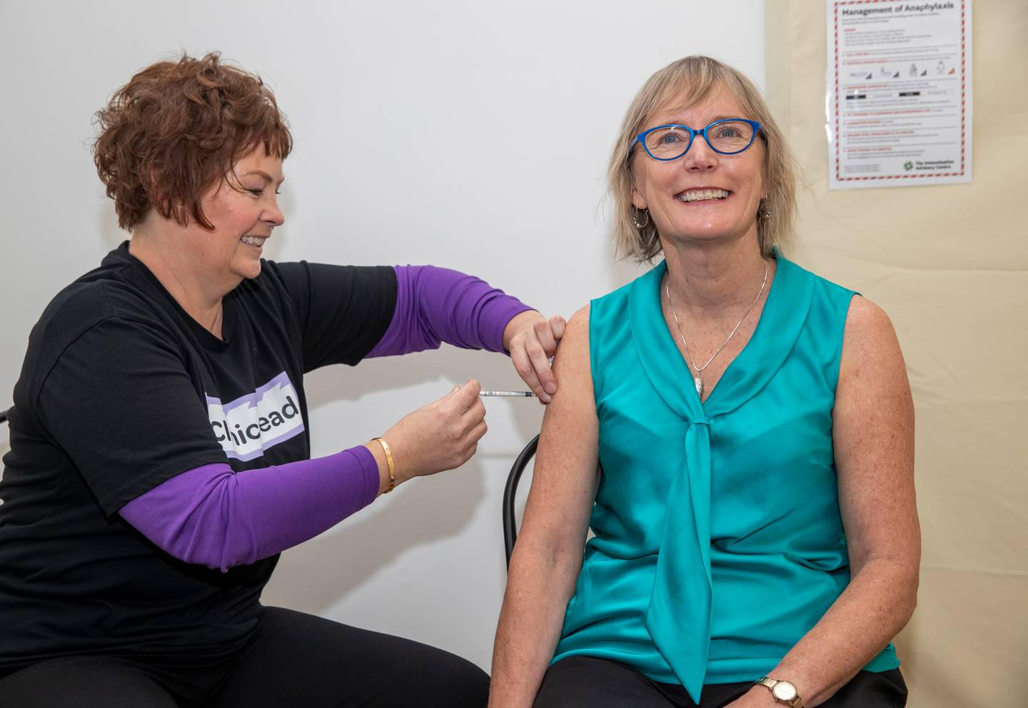 Dr Nikki Turner, seen here receiving the Pfizer Covid-19 vaccine from clinical lead Johanna Fowler at the Community Vaccination Centre in Wellington. Photo / Mark Mitchell