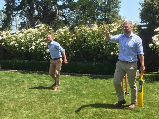 Wielding a plastic bat, Immigration Minister Iain Lees-Galloway, right, hits it for six, while Wairarapa MP Kieran McAnulty watches. Photo / Jason Walls