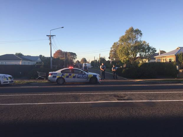 Police at the cordon on Glasgow St in Phillipstown, Christchurch. Photo / Jack Loader