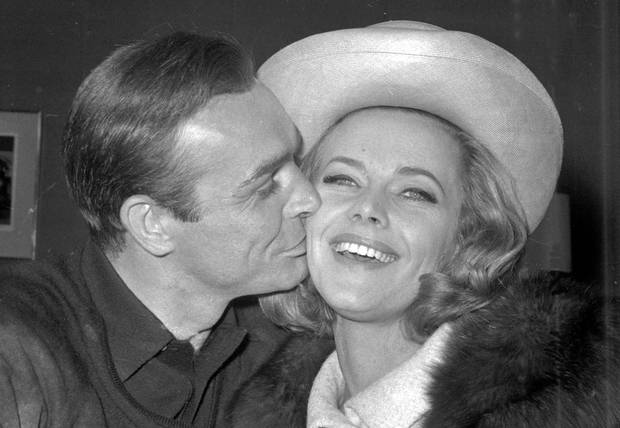 Sean Connery kisses Honor Blackman during a party at Pinewood Film Studios. Photo / AP