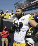 Pittsburgh Steelers offensive tackle and former Army Ranger Alejandro Villanueva (78) stands outside the tunnel alone during the national anthem before an NFL football game. Photo / AP.