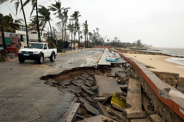 A car drives past a destroyed section of the road after Tropical Cyclone Idai hit land in Beira, Mozambique. Photo / Red Cross, via AP