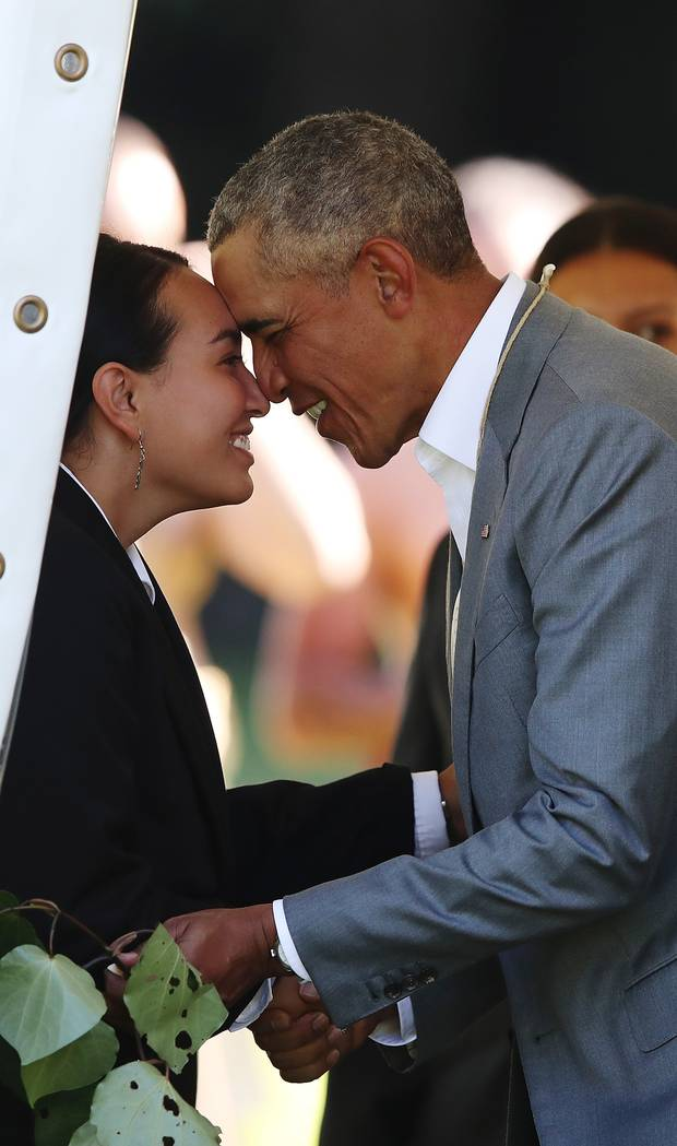 Barack Obama receives a Maori hongi during a powhiri at Government House yesterday. Photo / Getty