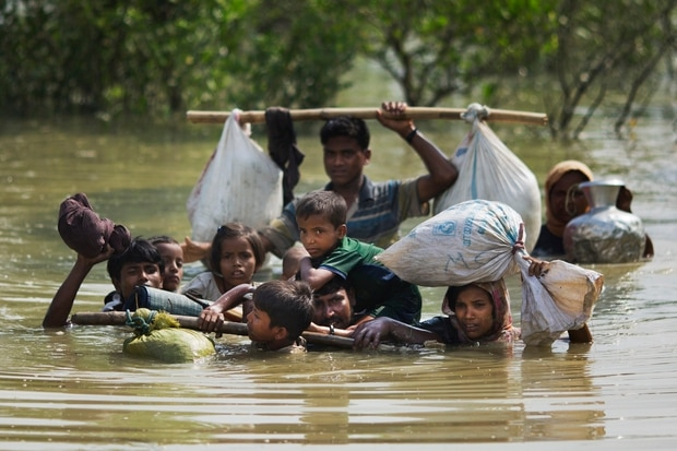 A Rohingya family reaches the Bangladesh border after crossing a creek of the Naf river on the border with Myanmmar, in Cox's Bazar's Teknaf area. Photo / AP