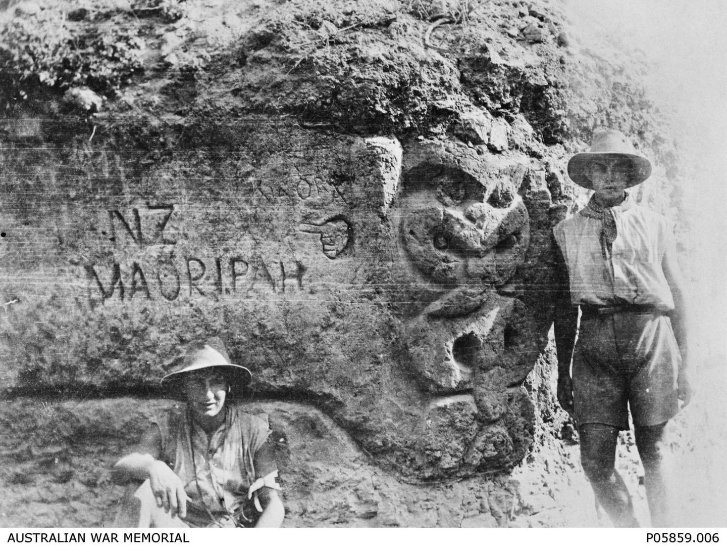 """Australian soldiers at Gallipoli in World War 1 posed with a rock labelled """"NZ Maori Pah."""" Photo / File."""