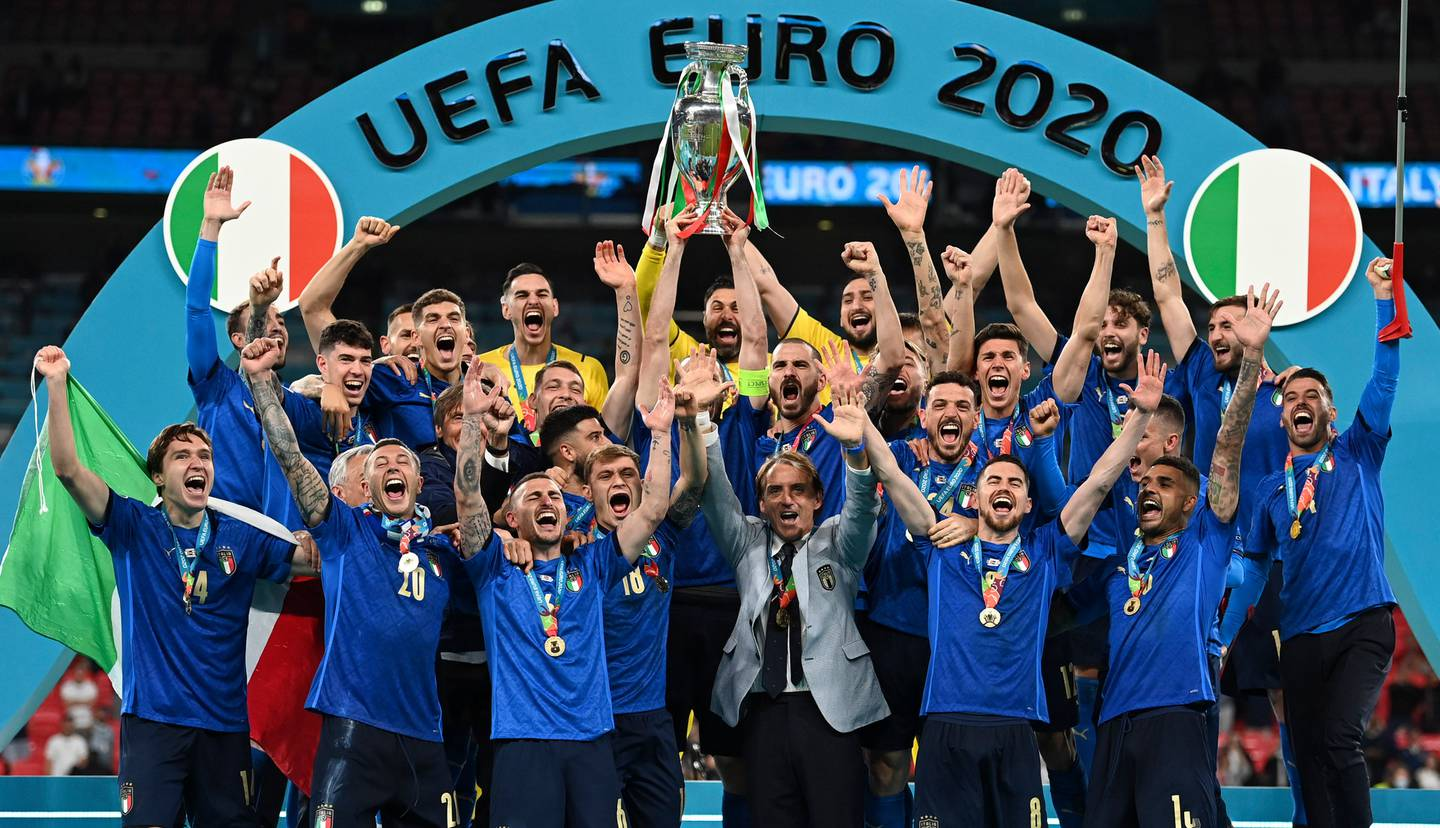 Italy's team celebrates with the trophy on the podium after winning the Euro 2020 final. Photo / AP