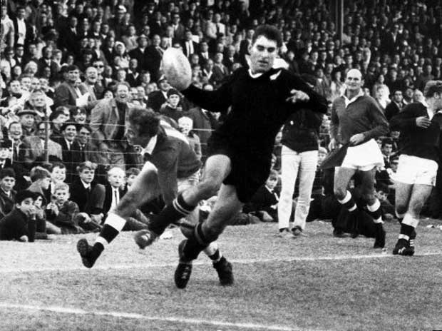 All Blacks legend Colin Meads evades a tackle in the match against Border during the 1970 tour of South Africa.