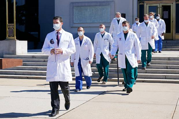 Dr. Sean Conley, physician to President Donald Trump, is followed by a team of doctors for a briefing with reporters at Walter Reed National Military Medical Center. Photo / AP