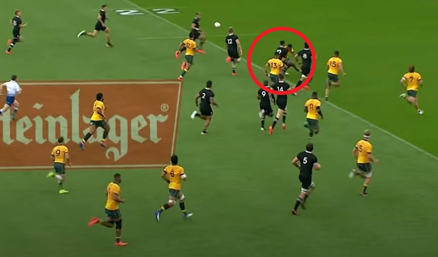 All Blacks first-five Richie Mo'unga is hit late by a Wallabies defender after offloading to Rieko Ioane in the first half of the test in Wellington on Sunday. Photo / SKY Sport