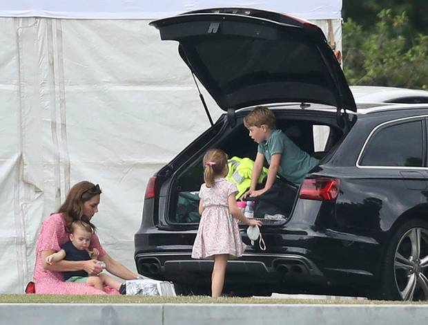 Britain's Kate The Duchess of Cambridge sits with Prince Louis, with Prince George, right, and Princess Charlotte during the King Power Royal Charity Polo Day at Billingbear Polo Club. Photo / AP