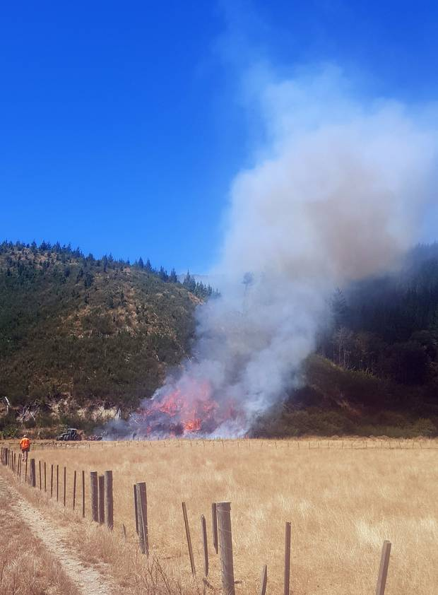 The <i>Herald</i> revealed on Wednesday that a contractor ploughing a tinder-dry field up Pigeon Valley was suspected to have sparked the blaze. Photo / Joel Scott