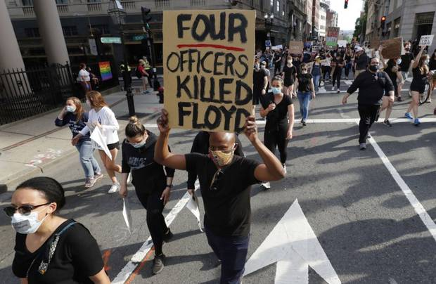 People march in protest against police brutality in Boston today following the death of George Floyd, who died after being restrained by Minneapolis police officers. Photo / AP